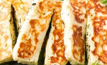 Chargrilled haloumi skewers served warm